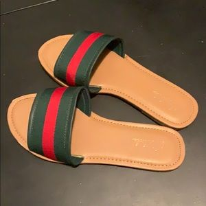 Green and red slide sandals